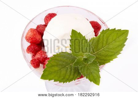 Ice-cream with fresh berries of a strawberry and leaf of mint on a white background.