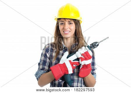 Attractive young woman builder with drill tool happy for good work. Isolated on white background.