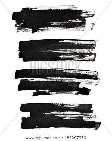 Set of textured black brush strokes isolated on the white background