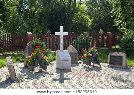 PETROPAVL, KAZAKHSTAN - JULY 24, 2015: Memorial to the memory of Polish Russian and other victims of the totalitarian regime and repressions of the Soviet era. Sign is located near catholic church.