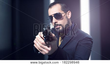 Secret agent holding a gun
