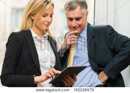 Business people using a tablet in their office