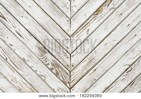 Old wooden gate is covered with shabby white paint. Simply background.