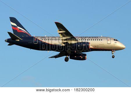 SHEREMETYEVO, MOSCOW REGION, RUSSIA - JULY 13, 2015: Aeroflot Sukhoi Superjet-100 RA-89045 landing at Sheremetyevo international airport.