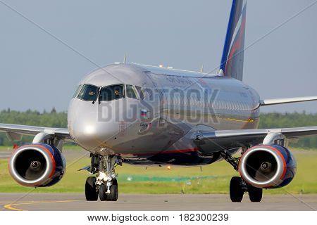 SHEREMETYEVO, MOSCOW REGION, RUSSIA - JULY 1, 2015: Aeroflot Sukhoi Superjet-100 RA-89024 landing at Sheremetyevo international airport.