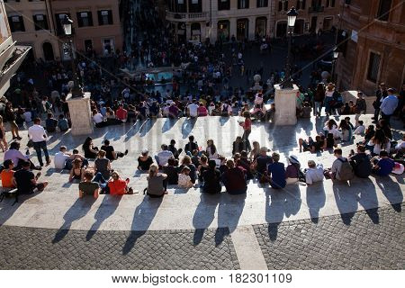 ROME, ITALY - APRIL 10, 2017: Spanish Steps and Square of Spain (Piazza di Spagna) popular meeting places in Rome, Italy on April 10, 2017
