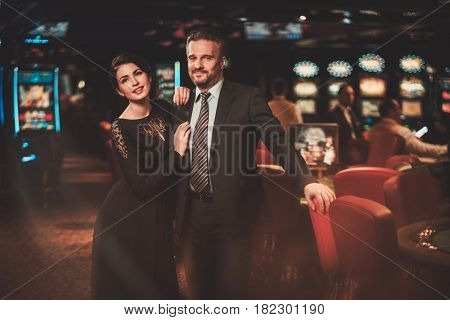 Well-dressed couple in a luxury casino interior
