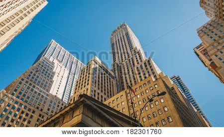 Giant skyscrapers dominate city streets of Wall Street. Lower Manhattan New York City