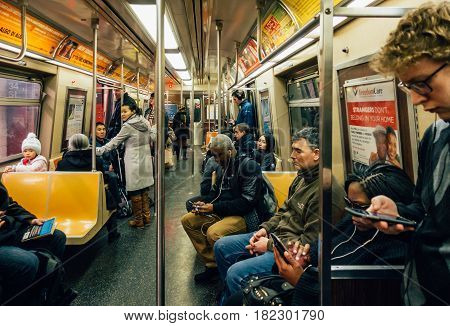 New York Usa - March 18 2017: Passengers riding in the NYC Subway.