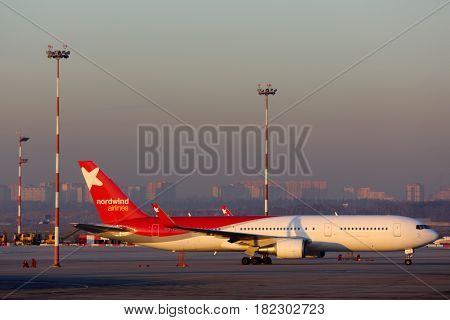 SHEREMETYEVO, MOSCOW REGION, RUSSIA - MARCH 16, 2014: Nordwind Airlines Boeing 767-300 VP-BOQ standing at Sheremetyevo international airport.