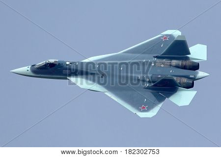 ZHUKOVSKY, MOSCOW REGION, RUSSIA - NOVEMBER 20, 2013: Sukhoi T-50 PAK-FA 055 BLUE prototype is a brand new fifth generation jet fighter shown while arriving at Zhukovsky airport.