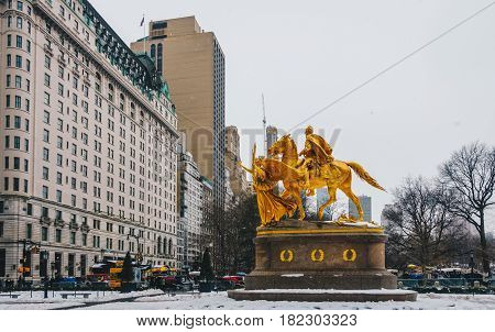 New York City USA - March 18 2017: Grand Army Plaza lies at the intersection of Central Park South and Fifth Avenue in front of the Plaza Hotel in Manhattan.