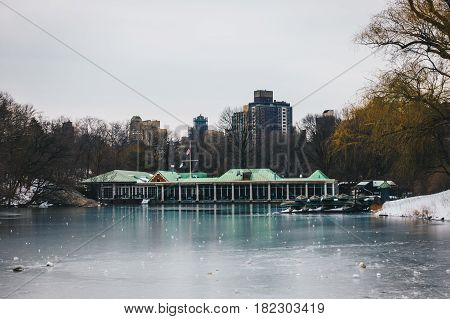 Central Park Boathouse and iced lake in New York City USA