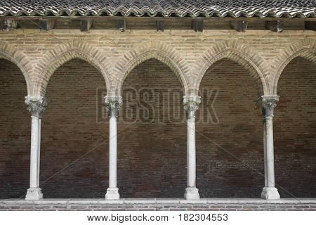 Columns and arches of cloister in Dominican monastery Couvent des Jacobins in Toulouse, France.