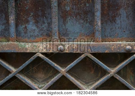 Fragment of old metal rusty gate painted blue. Architectural detail, Toulouse, France.