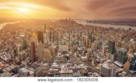 The New York City USA .Manhattan downtown and New Jersey skyline skyscrapers at sunset with the Freedom tower and Brooklyn bridge. Extreme Panorama