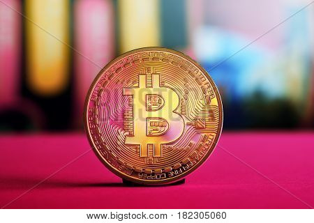 motley  golden bitcoin on colorful background