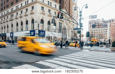 New York City USA - March 21 2017: Yellow Taxi cabs on the street of New York. The architecture of Manhattan with symbolic yellow taxis. The financial and cultural capital of the world. Motion Blurred.
