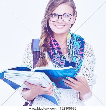 Portrait of a young student woman holding exercise books.