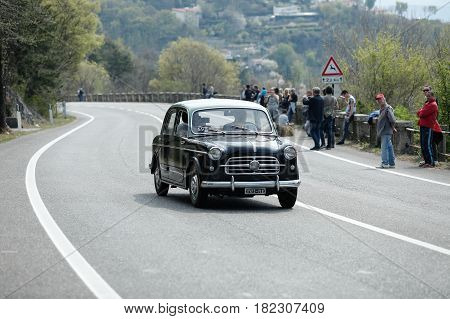 Trieste Italy - April 2 2017: Photo of a Fiat 1100 on the Trieste Opicina Historic. Trieste Opicina Historic is regularity run for vintage and classic Cars.