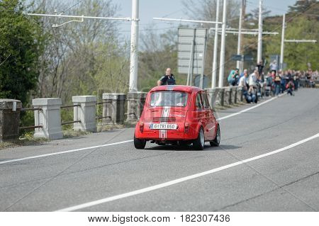 Trieste Italy - April 2 2017: Photo of a Steyr-Puch 500 on the Trieste Opicina Historic. Trieste Opicina Historic is regularity run for vintage and classic Cars.
