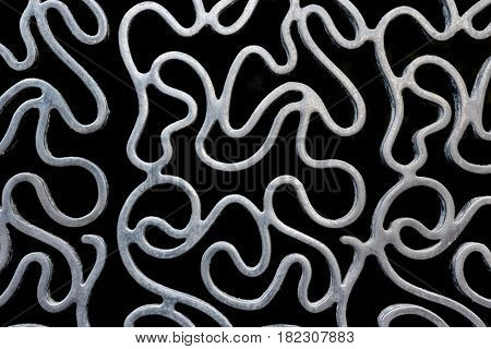 Abstract squiggly metal lines pattern