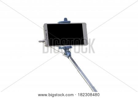 Selfie stick with mobile phone isolated on white background