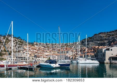 View of vacation house in marina Porto piccolo Sistiana Italy with sailing boats