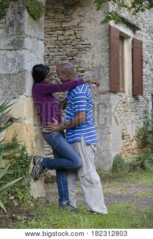 African couple about to kiss outdoors