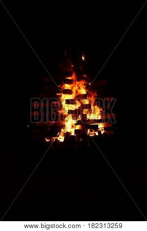 Among night strong fire gives the chance to consider burning logs combined in a pyramid.