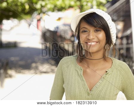 Smiling Hispanic woman outdoors