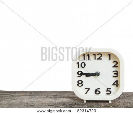 Closeup white clock for decorate show a quarter to nine o'clock or 8:45 a.m. on old brown wood desk isolated on white background with copy space
