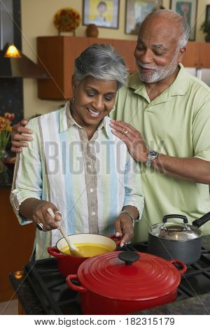 African couple making dinner