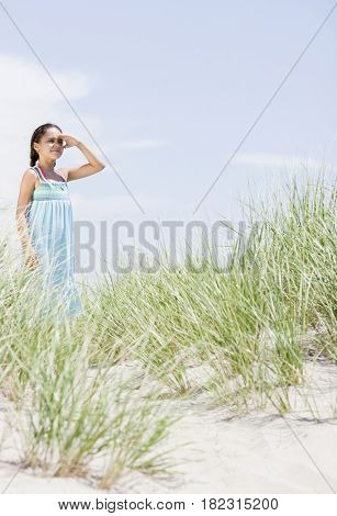 Hispanic girl viewing scenery at beach