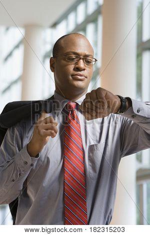 African businessman checking watch
