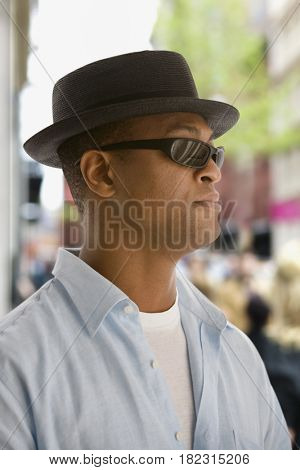 African man in hat and sunglasses