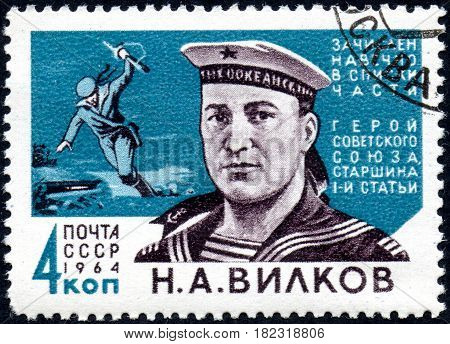 UKRAINE - CIRCA 2017: A postage stamp printed in USSR shows Hero of USSR Sergeant N.A.Vilkov 1918-1945 from the series Heroes of World War II forever in military lists circa 1964