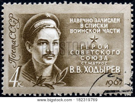 UKRAINE - CIRCA 2017: A postage stamp printed in USSR shows Hero of USSR Guard Seaman V.V.Hodyrev 1923-1944 from the series Heroes of World War II forever in military lists circa 1967