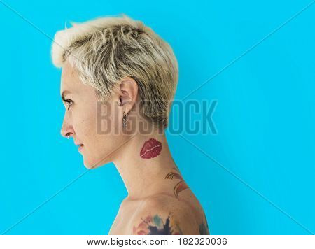 tattooed Caucasian bare chested woman