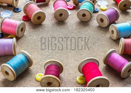 spools of thread laid out in a circle