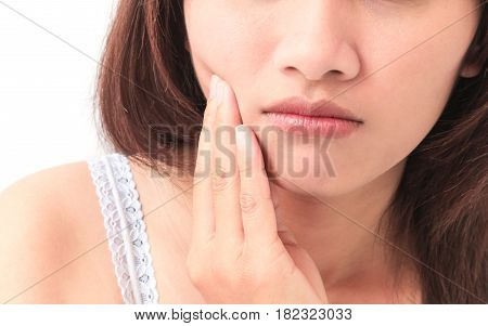 Closeup woman toothache with white background health care and medical concept