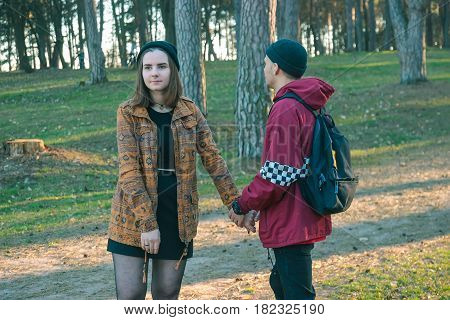 two happy homeless man and woman hold hands each other in the evening