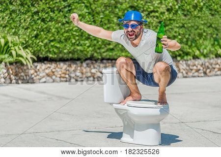 The Bearded Man In Goggles Astride The Toilet, Which Is Installed In The Middle Of The Street. Toile
