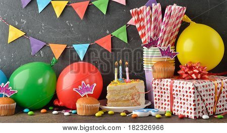 Accessories for children's parties on a brown background