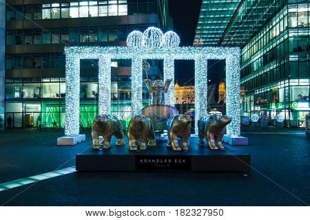 BERLIN - DECEMBER 07 2016: Neues Kranzler Eck. West Berlin. Installation - the Brandenburg Gate in the Christmas illuminations and the symbol of the city - Buddy Bear Quadriga.