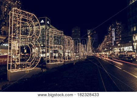 BERLIN - DECEMBER 07 2016: The shopping street of West Berlin Tauentzienstrasse in the Christmas illuminations. Stylization. Toning.
