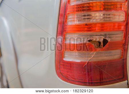 Closeup broken rear light   at back car.