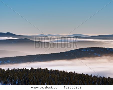 In Winter Mountains. Peaks Of  Mountains Above Creamy Mist.