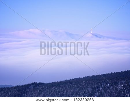 Far Mountain Peak With Observatory Above Creamy Mist.