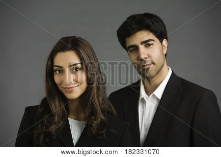 Middle Eastern business people smiling